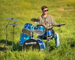 Jazz Drummer Senior Portrait in a Field